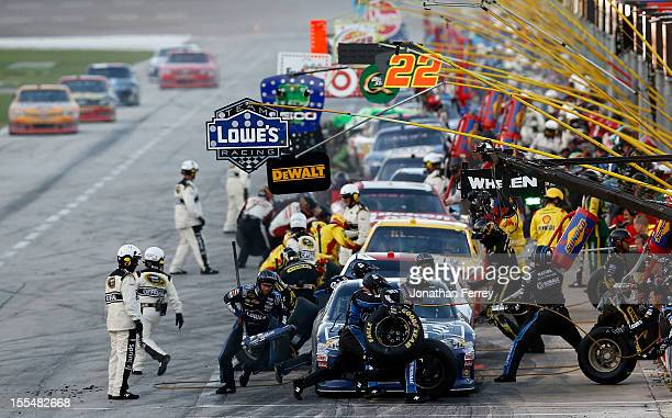 Jimmie Johnson driver of the Lowe's Chevrolet pits during the NASCAR Sprint Cup Series AAA Texas 500 at Texas Motor Speedway on November 4 2012 in...