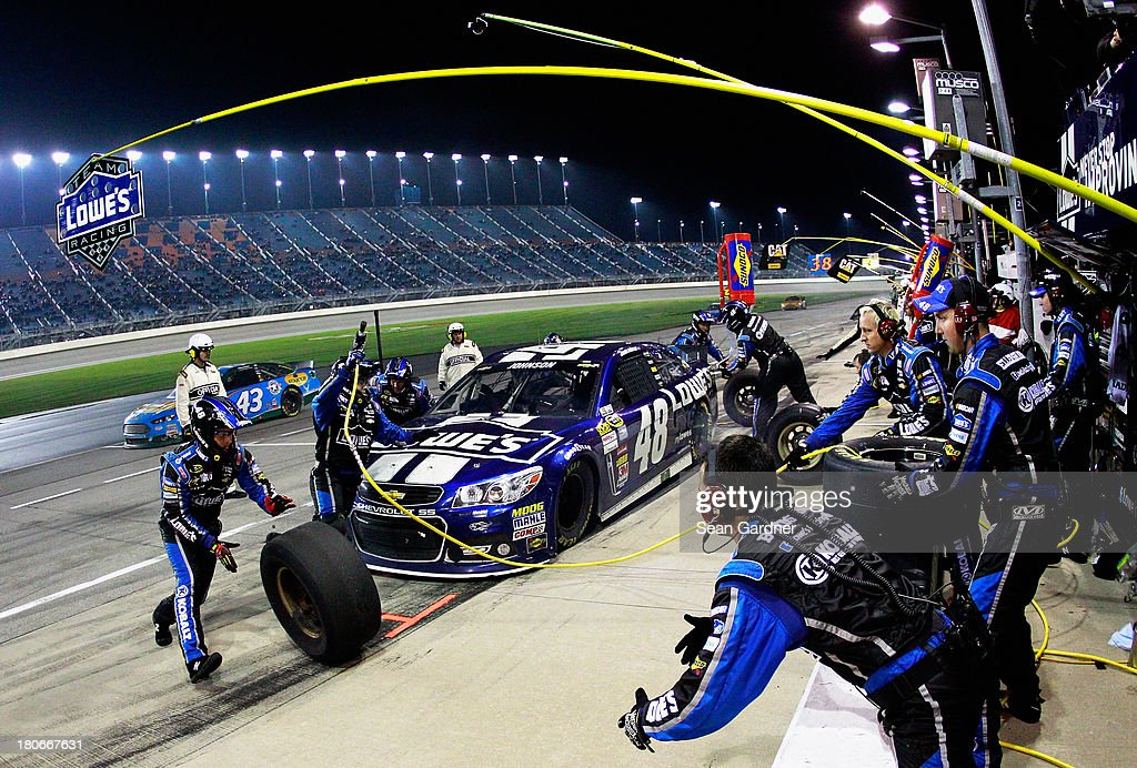 Jimmie Johnson, driver of the #48 Lowe's Chevrolet, pits during the NASCAR Sprint Cup Series Geico 400 at Chicagoland Speedway on September 15, 2013 in Joliet, Illinois.