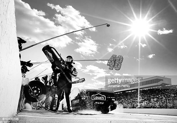 Jimmie Johnson driver of the Lowe's Chevrolet pits during the NASCAR Sprint Cup Series Bad Boy Off Road 300 at New Hampshire Motor Speedway on...