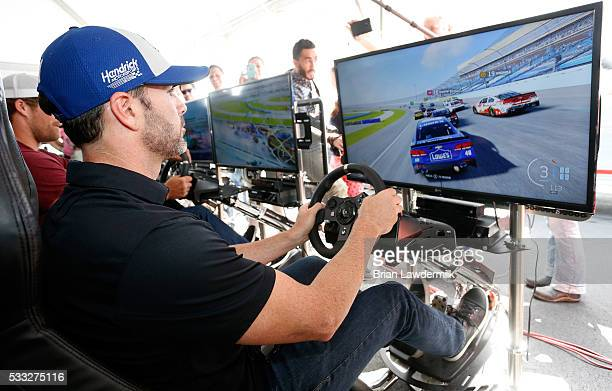 Jimmie Johnson driver of the Lowe's Chevrolet plays video games prior to the NASCAR Sprint Cup Series Sprint AllStar Race at Charlotte Motor Speedway...