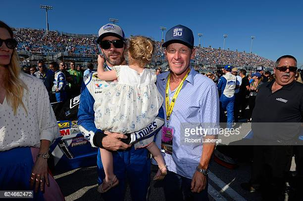 Jimmie Johnson driver of the Lowe's Chevrolet poses with former professional road racing cyclist Lance Armstrong on the grid during prerace...