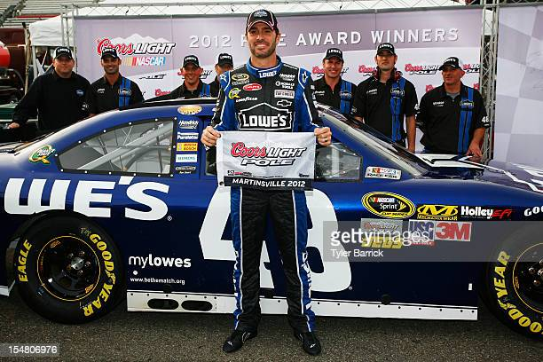 Jimmie Johnson driver of the Lowe's Chevrolet poses with the Coors Light Pole Award after qualifying for pole position for the NASCAR Sprint Cup...