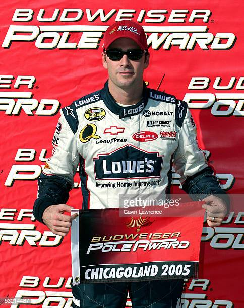 Jimmie Johnson driver of the Lowe's Chevrolet poses with the Pole Award after qualifying for pole position during the NASCAR Nextel Cup Series USG...