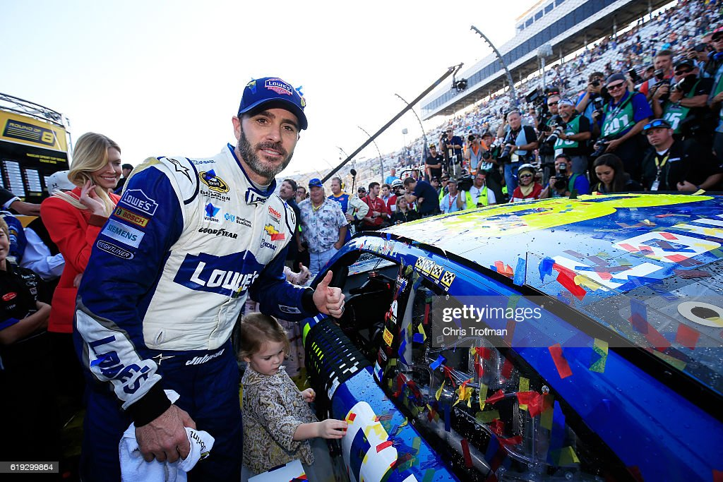 Jimmie Johnson, driver of the #48 Lowe's Chevrolet, poses with the winner's decal in Victory Lane after winning the NASCAR Sprint Cup Series Goody's Fast Relief 500 at Martinsville Speedway on October 30, 2016 in Martinsville, Virginia.
