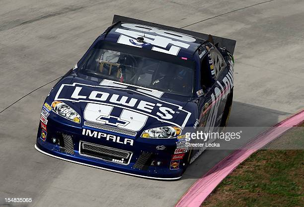 Jimmie Johnson driver of the Lowe's Chevrolet practices for the NASCAR Sprint Cup Series Tums Fast Relief 500 at Martinsville Speedway on October 27...