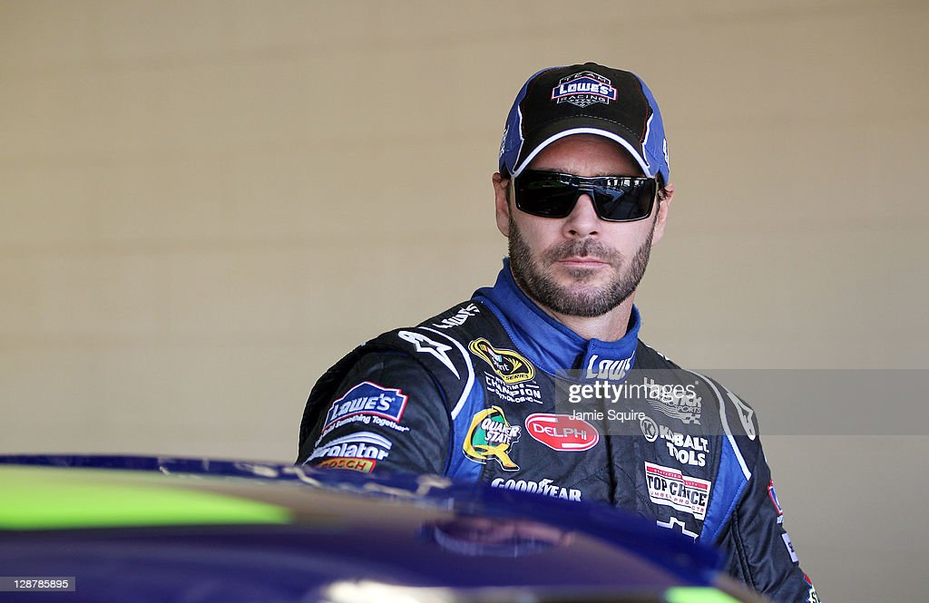 Jimmie Johnson, driver of the #48 Lowe's Chevrolet, prepares to drive during practice for the NASCAR Sprint Cup Series Hollywood Casino 400 at Kansas Speedway on October 7, 2011 in Kansas City, Kansas.