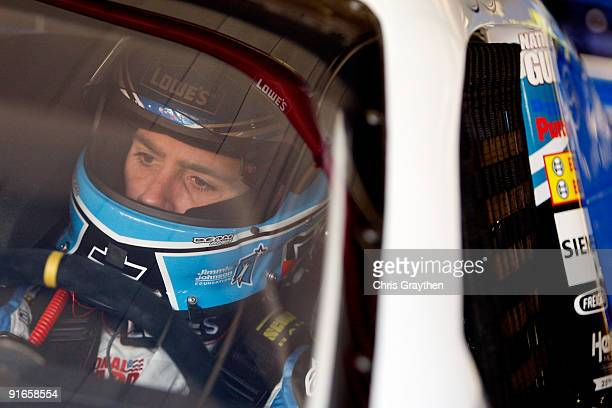 Jimmie Johnson driver of the Lowe's Chevrolet prepares to drive during practice for the NASCAR Sprint Cup Series Pepsi 500 at Auto Club Speedway on...