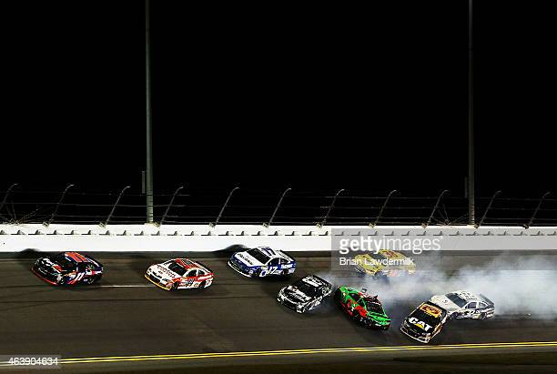 Jimmie Johnson driver of the Lowe's Chevrolet races Austin Dillon driver of the DOW Chevrolet during the NASCAR Sprint Cup Series Budweiser Duel 2 at...