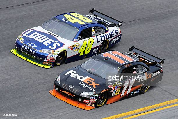 Jimmie Johnson driver of the Lowe's Chevrolet races Denny Hamlin driver of the FedEx Express Toyota during the first NASCAR Sprint Cup Series...