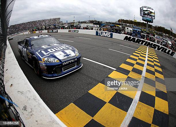 Jimmie Johnson driver of the Lowe's Chevrolet races during the NASCAR Sprint Cup Series Tums Fast Relief 500 at Martinsville Speedway on October 28...