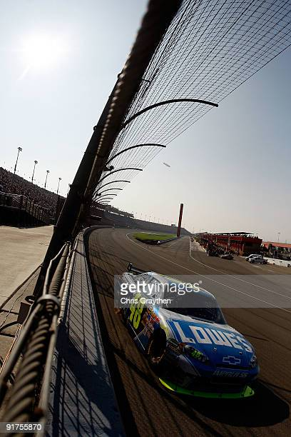 Jimmie Johnson driver of the Lowe's Chevrolet races during the NASCAR Sprint Cup Series Pepsi 500 at Auto Club Speedway on October 11 2009 in Fontana...