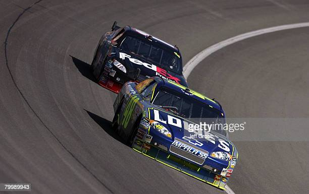 Jimmie Johnson driver of the Lowe's Chevrolet races in front of Denny Hamlin driver of the FedEx Freight Toyota during the NASCAR Sprint Cup Series...
