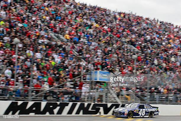 Jimmie Johnson driver of the Lowe's Chevrolet races to the checkered flag to win the NASCAR Sprint Cup Series Tums Fast Relief 500 at Martinsville...