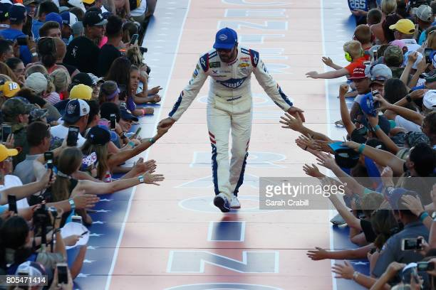 Jimmie Johnson driver of the Lowe's Chevrolet shakes hands with fans before the Monster Energy NASCAR Cup Series 59th Annual Coke Zero 400 Powered By...