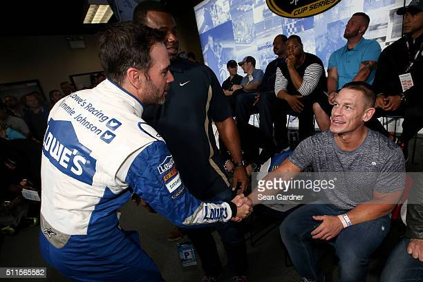 Jimmie Johnson driver of the Lowe's Chevrolet shakes hands with John Cena at the driver's meeting prior to the NASCAR Sprint Cup Series DAYTONA 500...