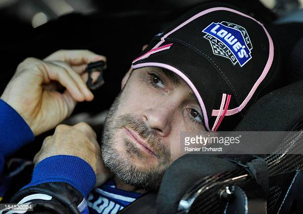 Jimmie Johnson driver of the Lowe's Chevrolet sits in his car in the garage area during practice for the NASCAR Sprint Cup Series Tums Fast Relief...
