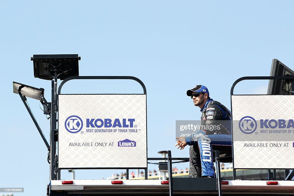 Jimmie Johnson, driver of the #48 Lowe's Chevrolet, sits in the garage area during practice for the NASCAR Sprint Cup Series Hollywood Casino 400 at Kansas Speedway on October 7, 2011 in Kansas City, Kansas.