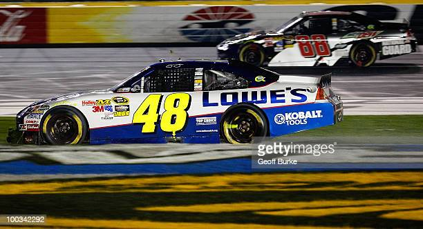 Jimmie Johnson driver of the Lowe's Chevrolet spins out on to the grass after an incident during the NASCAR Sprint AllStar Race at Charlotte Motor...
