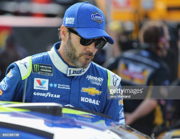 Jimmie Johnson driver of the Lowe's Chevrolet stands by his car during qualifying for the Monster Energy NASCAR Cup Series Bass Pro Shops NRA Night...