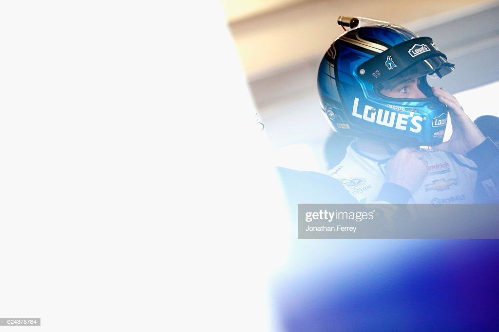Jimmie Johnson, driver of the #48 Lowe's Chevrolet, stands in the garage area during practice for the NASCAR Sprint Cup Series Ford EcoBoost 400 at Homestead-Miami Speedway on November 19, 2016 in Homestead, Florida.