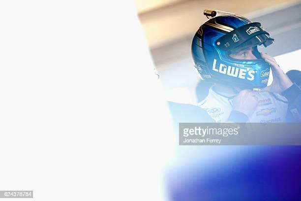 Jimmie Johnson driver of the Lowe's Chevrolet stands in the garage area during practice for the NASCAR Sprint Cup Series Ford EcoBoost 400 at...