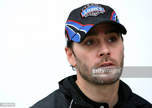Jimmie Johnson driver of the Lowe's Chevrolet stands in the garage area during practice for the NASCAR Sprint Cup Series Goody�s Fast Pain Relief 500...