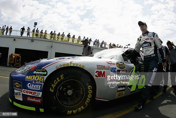 Jimmie Johnson driver of the Lowe's Chevrolet stands next to his vehicle during practice for the NASCAR Nextel Cup Daytona 500 February 16 2005 at...