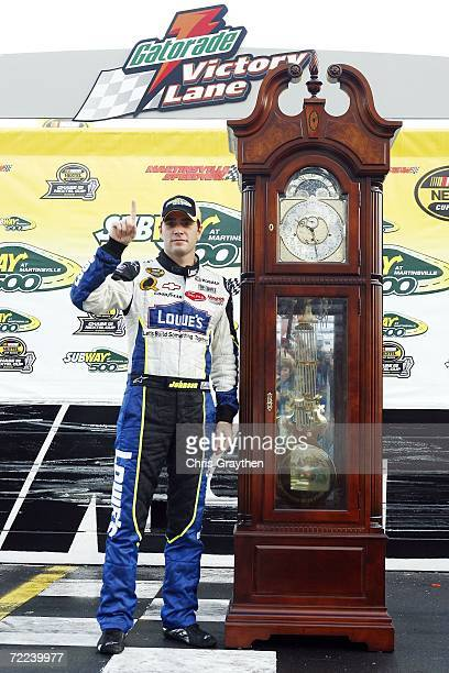Jimmie Johnson driver of the Lowe's Chevrolet stands next to the Grandfather Clock trophy following the NASCAR Nextel Cup Series Subway 500 on...