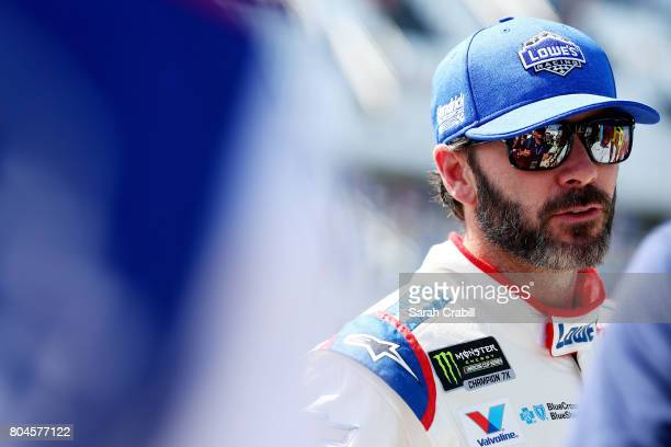 Jimmie Johnson, driver of the Lowe's Chevrolet, stands on the grid during qualifying for the Monster Energy NASCAR Cup Series 59th Annual Coke Zero...