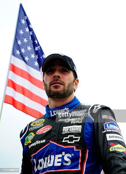 Jimmie Johnson driver of the Lowe's Chevrolet stands on the grid prior to the NASCAR Sprint Cup Series FedEx 400 Benefiting Autism Speaks at Dover...