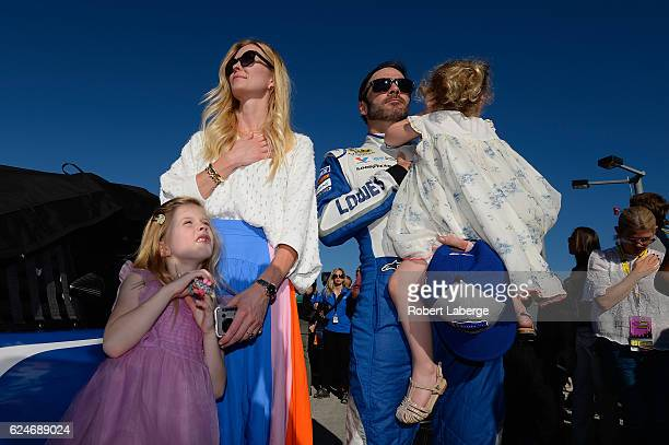 Jimmie Johnson driver of the Lowe's Chevrolet stands on the grid with his wife Chandra and daughters Genevieve Marie and Lydia Norriss during prerace...
