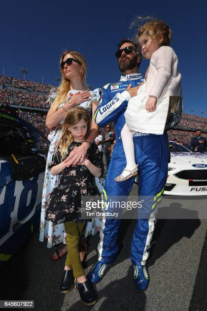Jimmie Johnson driver of the Lowe's Chevrolet stands on the grid with his wife Chandra Johnson and their daughters Lydia Norriss Johnson and...