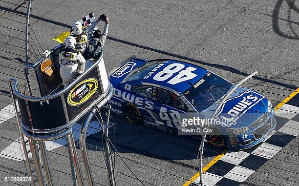 Jimmie Johnson driver of the Lowe's Chevrolet takes the checkered flag to win the NASCAR Sprint Cup Series Folds of Honor QuikTrip 500 at Atlanta...
