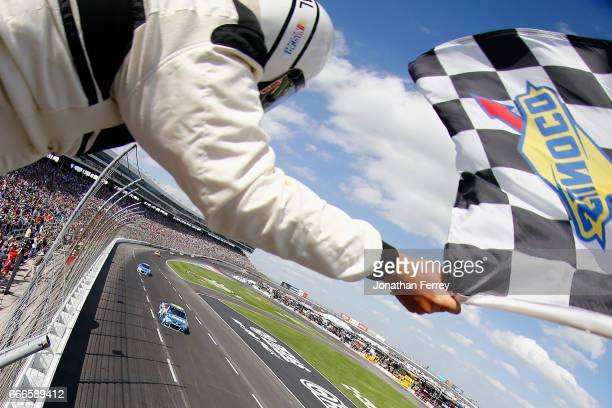 Jimmie Johnson driver of the Lowe's Chevrolet takes the checkered flag to win the Monster Energy NASCAR Cup Series O'Reilly Auto Parts 500 at Texas...
