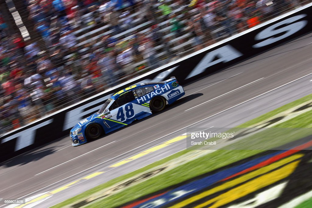 jimmie johnson, driver of the lowe's chevrolet, takes the checkered