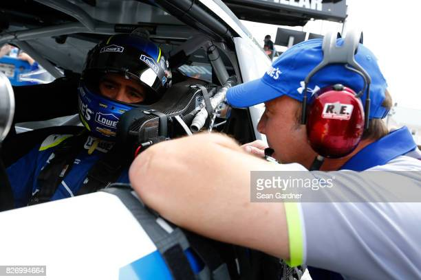 Jimmie Johnson driver of the Lowe's Chevrolet talks with crew chief Chad Knaus during qualifying for the Monster Energy NASCAR Cup Series I Love NY...