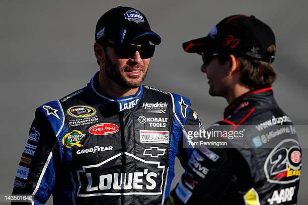 Jimmie Johnson driver of the Lowe's Chevrolet talks with teammate Jeff Gordon driver of the DuPont Chevrolet during qualifying for the NASCAR Sprint...