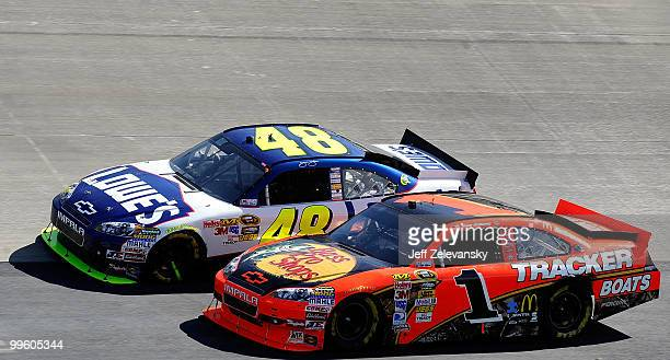 Jimmie Johnson, driver of the Lowe's Chevrolet, tries to get onto pit road around Jamie McMurray, driver of the Bass Pro Shops Chevrolet, on the...