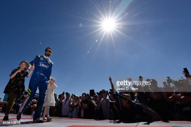 Jimmie Johnson driver of the Lowe's Chevrolet walks the driver's intros with his daughters Genevieve Johnson and Lydia Norriss before 59th Annual...