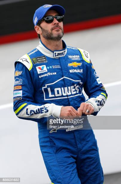 Jimmie Johnson driver of the Lowe's Chevrolet walks to his car during practice for the Bass Pro Shops NRA Night Race at Bristol Motor Speedway on...
