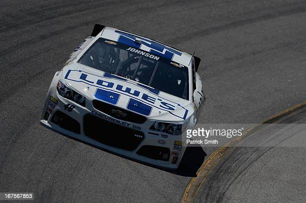 Jimmie Johnson driver of the Lowe's Dover White Chevrolet practices for the NASCAR Sprint Cup Series Toyota Owners 400 at Richmond International...