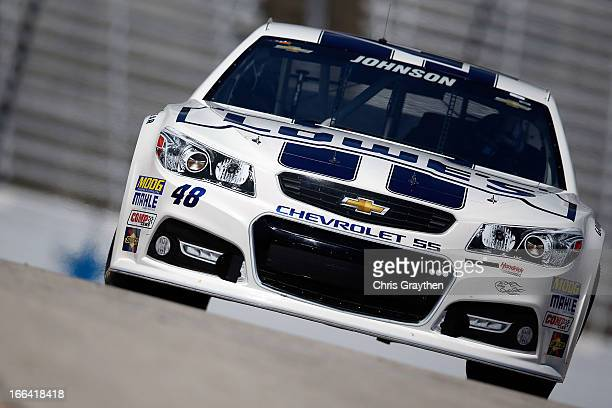 Jimmie Johnson driver of the Lowe's Dover White Chevrolet pulls into the garage area during practice for the NASCAR Sprint Cup Series NRA 500 at...