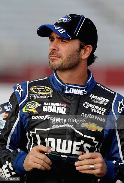 Jimmie Johnson driver of the Lowe's Dover White Chevrolet stands on the grstands on the gridduring qualifying for the NASCAR Sprint Cup Series...