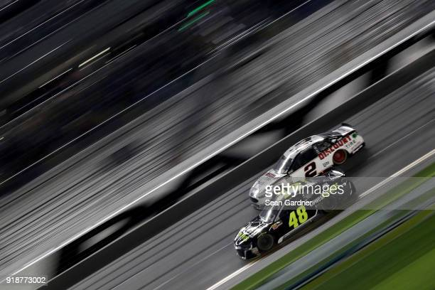 Jimmie Johnson driver of the Lowe's for Pros Chevrolet and Brad Keselowski driver of the Discount Tire Ford race during the Monster Energy NASCAR Cup...
