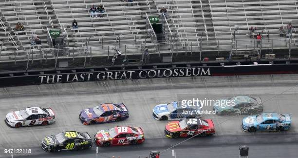 Jimmie Johnson driver of the Lowe's for Pros Chevrolet and Brad Keselowski driver of the Discount Tire Ford lead the field to a restart during the...