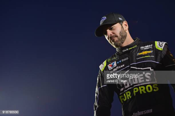 Jimmie Johnson driver of the Lowe's for Pros Chevrolet crosses the stage during driver introductions prior to the start of the Monster Energy NASCAR...