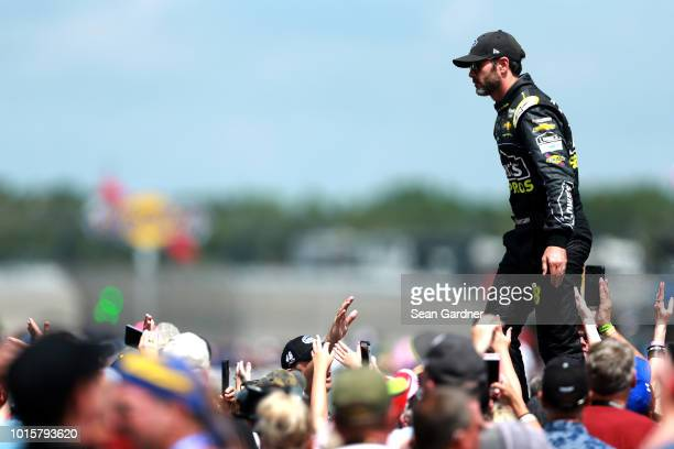 Jimmie Johnson driver of the Lowe's for Pros Chevrolet is introduced during prerace festivities for the Monster Energy NASCAR Cup Series Consmers...