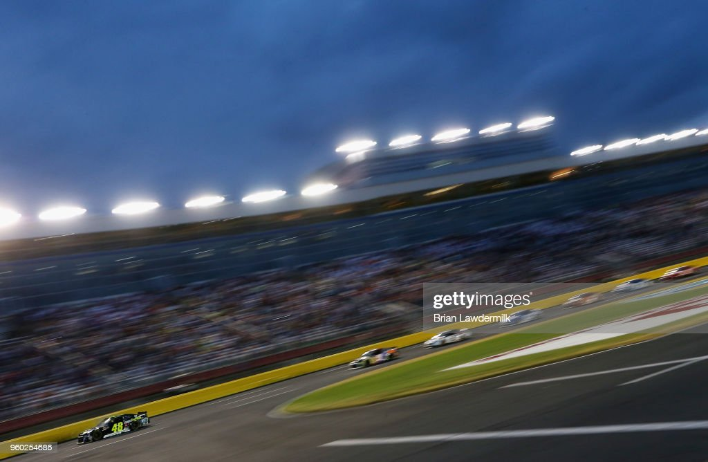 Jimmie Johnson, driver of the #48 Lowe's for Pros Chevrolet, leads a pack of cars during the Monster Energy NASCAR Cup Series All-Star Race at Charlotte Motor Speedway on May 19, 2018 in Charlotte, North Carolina.
