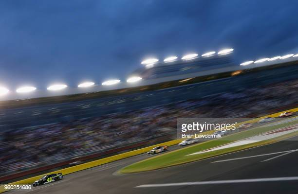 Jimmie Johnson driver of the Lowe's for Pros Chevrolet leads a pack of cars during the Monster Energy NASCAR Cup Series AllStar Race at Charlotte...