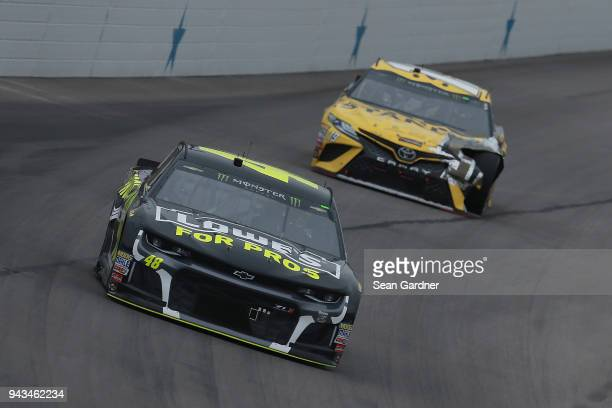 Jimmie Johnson driver of the Lowe's for Pros Chevrolet leads Daniel Suarez driver of the STANLEY Racing for a Miracle Toyota during the Monster...